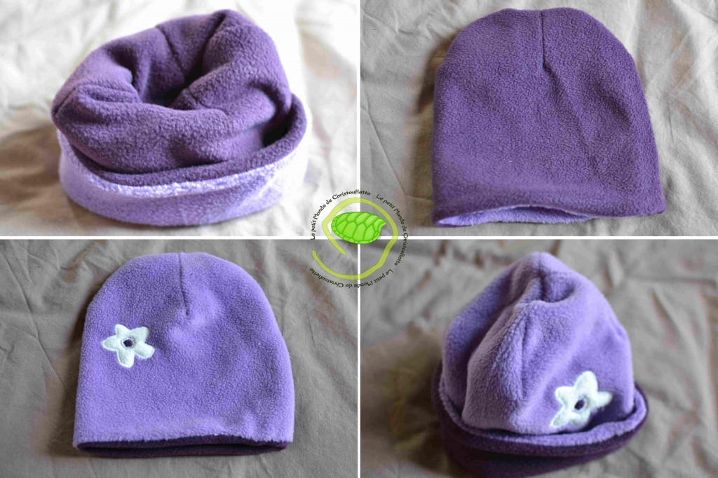 En polaire violette et parme. Il est réversible. Une petite fleur en polaire blanche pour décorer !