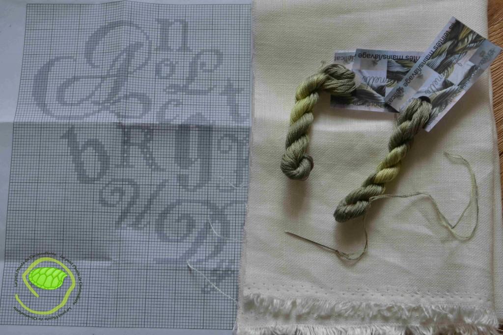 Du fil sapinette d'un petit fil Une toile de lin blanc au format de mon coussin