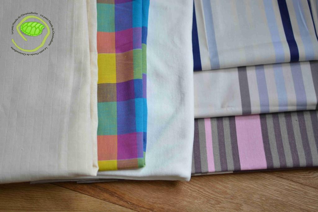 Du coton pour torchon, du madras, du velours, deux tissus enduits à rayures et du tissu d'ameublement à rayures
