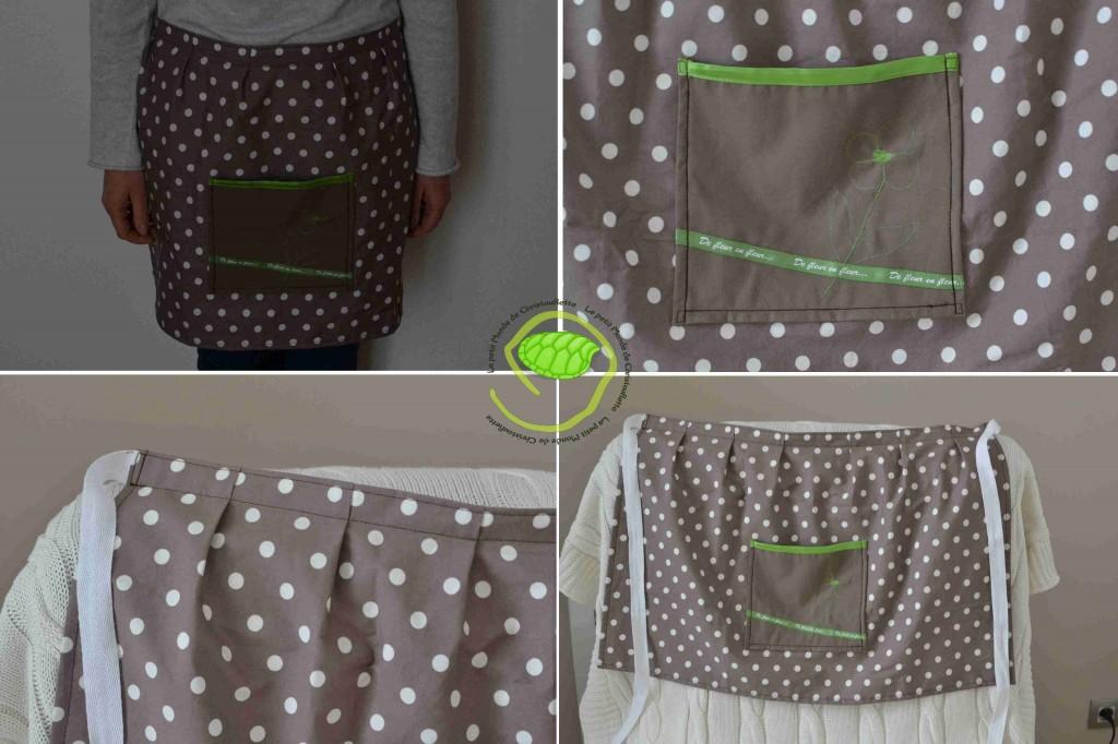 En coton taupe à pois blanc avec une sangle blanche et une poche taupe avec un biais en satin vert ainsi qu'un ruban et une fleur dans la même teinte.
